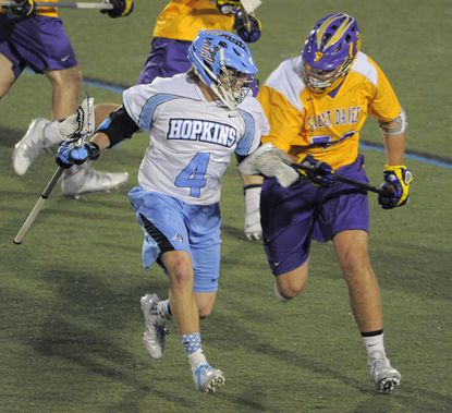 Johns Hopkins Blue Jays attack Ryan Brown (4) battles Albany Great Danes defender James Burdette at Homewood Field Friday., April 4, 2014.
