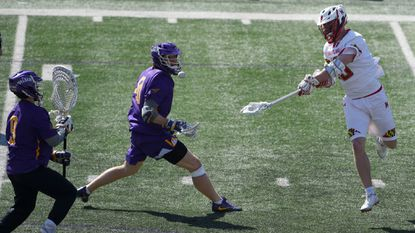 Sophomore attackman Jared Bernhardt, right, shoots during No. 2 Maryland's 11-10 loss to No. 1 Albany on Saturday.