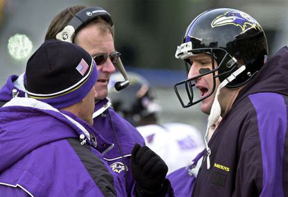 Ravens coach Brian Billick talks to quarterback Elvis Grbac during a playoff game against the Pittsburgh Steelers in 2002.