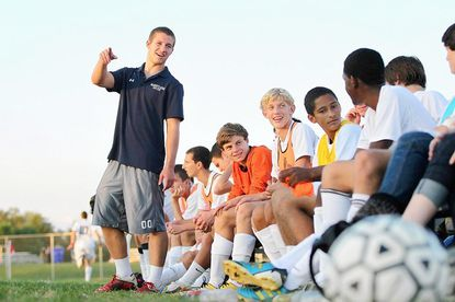 Marriotts Ridge High School's Pat Moore, left, talks to his teammates during the boys soccer game last week against visiting Howard. Moore was injured in a car accident earlier this year and no longer can play the sport.