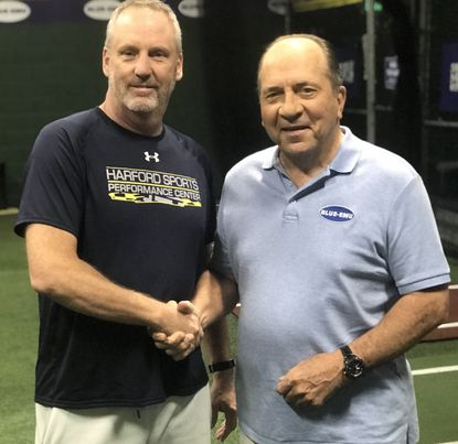 Danny Taylor and Johnny Bench shake hands Tuesday at the Harford Sports Performance Center.
