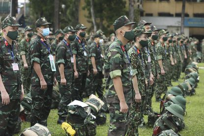 Army soldiers line up during a ceremony to send off military doctors to Ho Chi Minh City to help with treating COVID-19 patients in Hanoi, Vietnam, Monday, Aug. 23, 2021. Vietnam's largest metropolis Ho Chi Minh City has enabled a strict lockdown order to help curb the recent outbreak of the pandemic. (Bui Cuong Quyet/VNA via AP)