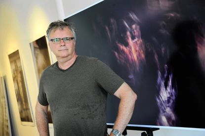 Artist Bernhard Hildebrandt is pictured with one of his photographs of a Caravaggio painting.