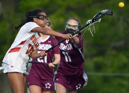 Dulaney's Sammy White gets a shot off before Towson's Tessa Snyder can block the attempt during a girls lacrosse game at Dulaney High School on Thursday, May 13, 2021.