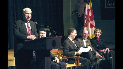 Sen. John McCain at podium with Sen. Russ Feingold, Rep. Wayne Gilchrest and Rep. Connie Morella duringa community meeting at St. John's College.