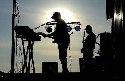 John Glenn, left, and Rick Zinn of the band Borderline perform onstage on the opening night of the Harney fire company carnival Thursday, June 24, 2021. The carnival runs nightly through Saturday, with the dining hall opening at 4 p.m. and the carnival grounds at 5.