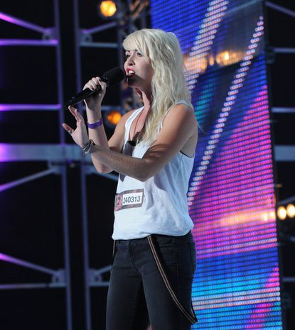 "Julia Bullock performs in front of the judges on ""The X Factor"""
