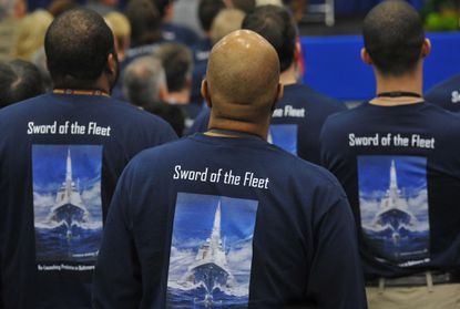 "Middle River, MD -- Many Lockheed Martin employees wore shirts with the motto of the MK 41 Vertical Launching System, ""Sword of the Fleet,"" at a Thursday ceremony to celebrate the reopening of the production line, thanks to a $253 million U.S. Navy contract."