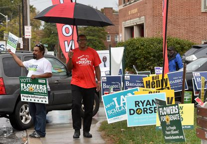 A Baltimore City Council committee is considering eliminating an unconstitutional regulation that dictates when people can start displaying campaign materials outside their homes and on their lawns. In this file photo campaign workers and many signs greeted voters at The League for People with Disabilities early polling site on Cold Spring Lane. Amy Davis/ Baltimore Sun