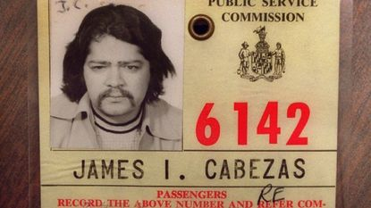 James Cabezas keeps his city taxi license from the early 1970's.