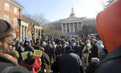 Hundreds of people rally outside the State House in 2019 supporting efforts to raise the state alcohol tax to prevent reductions in services to people with mental illness. (Barbara Haddock Taylor/Baltimore Sun).