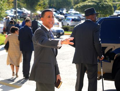 Lieutenant Governor Anthony Brown waves to church members as he leaves the 7:45 am service at Ebenezer AME Church