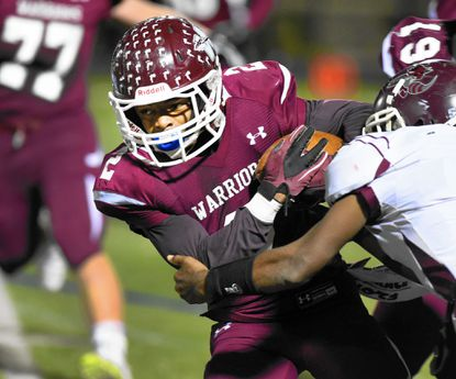 Knowledge Johnson carries the ball as he and the rest of the Havre de Grace Warriors advance in the state playoffs. The Havre de Grace football game is but one of a number of big playoff games involving Harford County teams this weekend.
