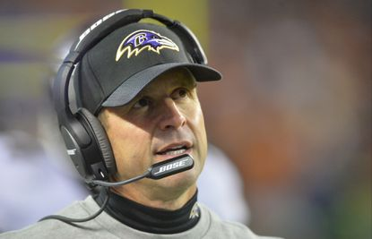 Ravens coach John Harbaugh reacts on the sideline during a game against the Cleveland Browns.