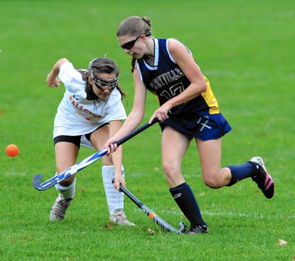 Perryville's Krissy McDuff lifts the ball over the stick of Fallston's Danielle Whiston as she moves in for the steal during Wednesday's Class 1A North title gameat Fallston. The Cougars won, 2-0.
