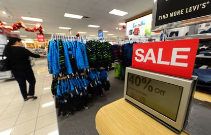 A woman shops at a Kohl's department store.