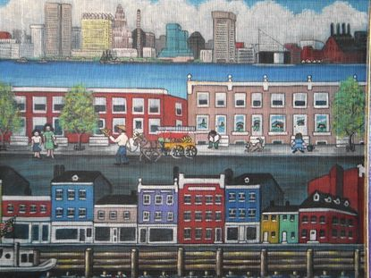 The Baltimore skyline, harbor and a neighborhood are all depicted in a window screen painting by Dee Herget on exhibit at the Meeting House Gallery in Columbia.