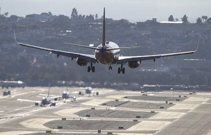 A Southwest Airlines passenger jet lands at San Diego International Airport.