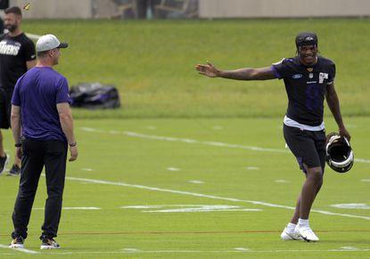 Baltimore Ravens head coach John Harbaugh and quarterback Lamar Jackson speak as players loosen during mandatory organized team activities on Tuesday, June 8, 2021. (Karl Merton Ferron/Baltimore Sun Staff)