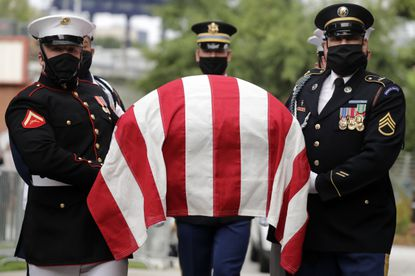 A military honor guard moved the casket of Rep. John Lewis into Ebenezer Baptist Church for his funeral Thursday in Atlanta. Lewis, who carried the struggle against racial discrimination from the Southern battlegrounds of the 1960s to the halls of Congress, died Friday, July 17.