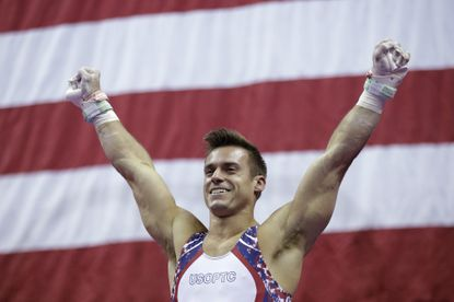 Samuel Mikulak celebrates after finishing the rings to win the men's all-around championship at the U.S. Gymnastics Championships on Saturday, Aug. 10, 2019, in Kansas City, Mo. (AP Photo/Charlie Riedel)