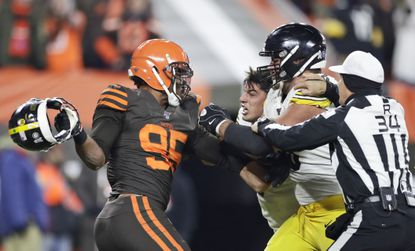 Cleveland Browns defensive end Myles Garrett, left, gets ready to hit Pittsburgh Steelers quarterback Mason Rudolph, second from left, with a helmet during the second half of an NFL football game Thursday, Nov. 14, 2019, in Cleveland. The Browns won, 21-7. (AP Photo/Ron Schwane)