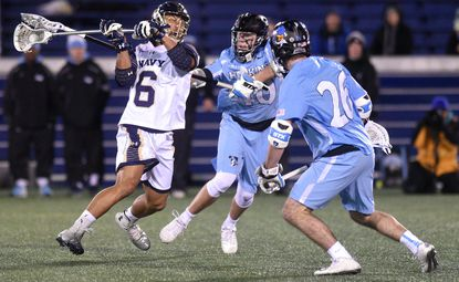 Navy's Greyson Torain prepares to shoots as Hopkins defends during Tuesday night's game at the Navy Marine Corps Memorial Stadium in Annapolis.