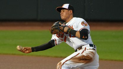 Orioles third baseman Manny Machado throws from behind second base after snaring a grounder hit by the Rangers' Shin-Soo Choo on July 1.