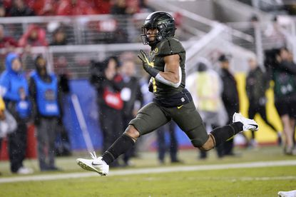 Oregon running back CJ Verdell runs for a touchdown against Utah during the second half of the Pac-12 championship game in Santa Clara, Calif., Friday, Dec. 6, 2018.