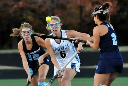 Garrison Forest's Dani Mendez, left, and teammate Macy Miller, right, surround NDP's Nicole Sann in the first halfof the IAAM field hockey A Conference championship game.