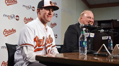 The Orioles' first-round draft pick pitcher Grayson Rodriguez, left, smiles as he is introduced by team's Director of Scouting Gary Rajsich, right, during a news conference before tonight's game against the Red Sox at Oriole Park at Camden Yards.