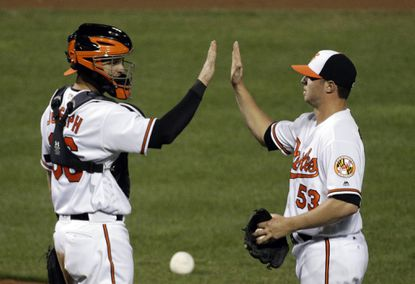 Orioles catcher Caleb Joseph, left, and relief pitcher Zach Britton high-five after a game against the Toronto Blue Jays in Baltimore, Thursday, April 21, 2016. Baltimore won, 3-2.