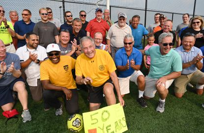 A large group of friends and fellow soccer officials join Harford County Soccer Officials Association member, Joe Manfre, front, as he celebrates his 50th year as a soccer referee at Cedar Lane Regional Park Monday, July 19, 2021. Manfre has mentored countless referees through the years and earned a place in the National Soccer Hall of Fame. Other than the hundreds of high school and recreation league games Joe Manfre has also rerereed in Pele's games, multiple NCAA finals, Baltimore Blast games and countless games in between.