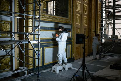 Art restorers at work at the Louvre in Paris on Ja. 8, 2021. With the Louvre closed because of the coronavirus pandemic, museum officials are pushing ahead on a grand restoration and cleanup.