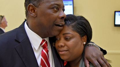 Del. Talmadge Branch comforts his daughter, Chanel Branch, before they spoke in support of increasing state funding for Safe Streets. They shared personal testimony before a House committee about their ongoing grief after Chanel's son Tyrone Ray was murdered last September.