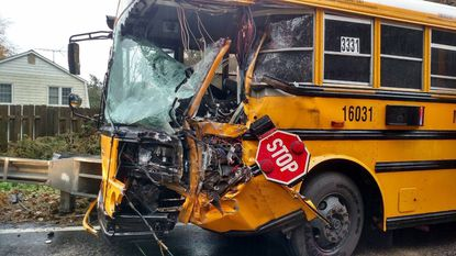 A Montgomery County school bus collided with a a garbage truck Monday, injuring nine students and two drivers.