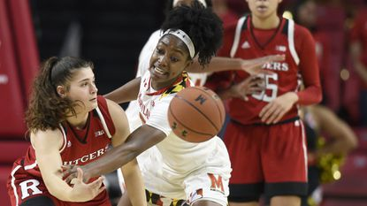 Marylands' Kaila Charles, right, defends as Rutgers Noga Peleg Pelc passes in the second half Monday, Dec. 31, 2018. Rutgers won, 73-65.
