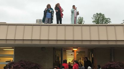 Bond Mill Elementary Assistant Principal Annette Mosier, resident Principal Ursula Golladay and guidance counselor Rona Pemberton slept on the roof for Pennies for Patients.
