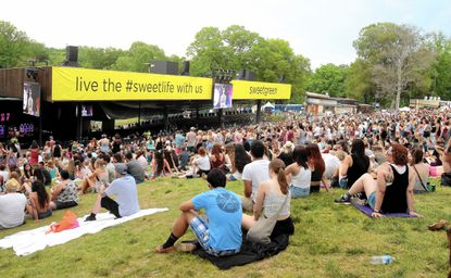 Concertgoers enjoy the sights and sounds of the 2015 Sweetlife Festival at Merriweather Post Pavilion on Sunday, May 31, 2015, in Columbia. (Photo by Owen Sweeney/Invision/AP)