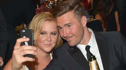 Amy Schumer and Ben Hanisch take a selfie at the 21st Annual Critics' Choice Awards in Santa Monica on Jan.17, 2016.