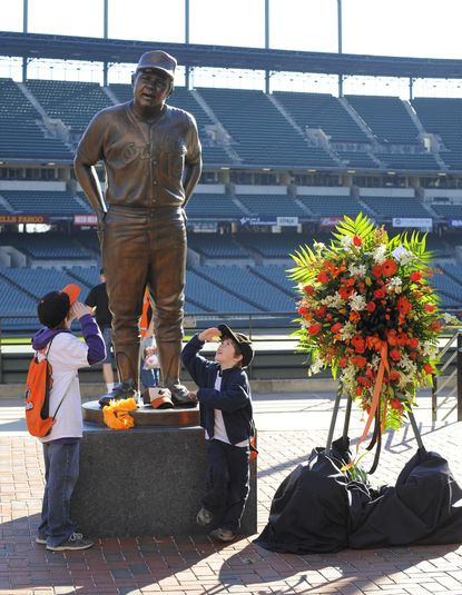 From left, McKinley Reese, 10, and his brother Hudson Reese, 6, both of Perry Hall, salute the statue of Earl Weaver at Camden Yards. Weaver died the night before.
