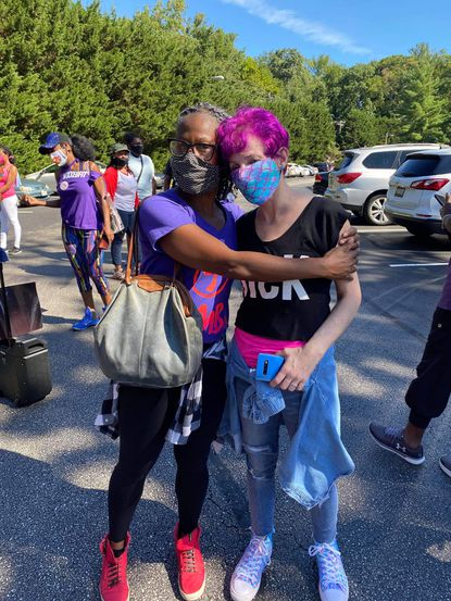 Towson Y instructors Kirsten Ledford, left, and Sonja Burns take a photo together to honor Burns' life after a terminal lung cancer diagnosis.