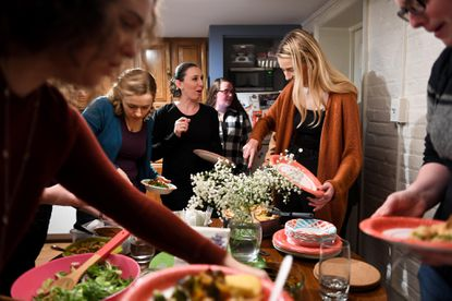 Women share a meal at a recent gathering of the Dinner Party, a community of young adults who have experienced significant loss.