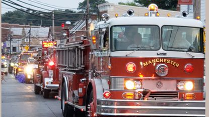 Manchester Volunteer Fire Company's firetruck cruises along the parade route on Aug. 15 during the Hampstead Fireman's Carnival parade. The Manchester fire company will be the site of a Sportsman's Bingo on Sept. 15.