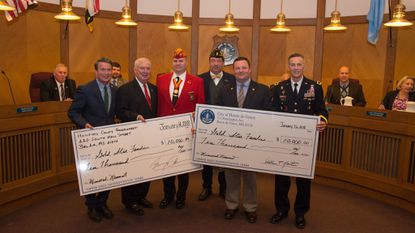 Holding checks for the Havre de Grace Gold Star Families Memorial are, from left, County Executive Barry Glassman, former county executive and mayor David Craig, monument committee co-chairs Craig Reeling and Johnny Boker, Mayor William T. Martin and Maj. Gen. Randy Taylor.