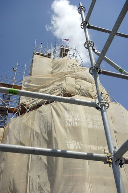 This is a view of the State House Dome covered by mesh netting during the restoration.