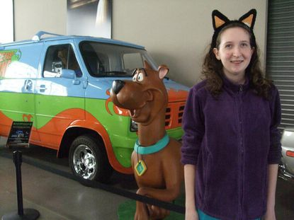 Morgan Arnold poses next to a Scooby-Doo display during a 2012 trip to California with her mother, Cindi Arnold. Morgan, 14, now stands accused of orchestrating a plot with her boyfriend, Jason Bulmer, to kill her father, Dennis Lane, in Ellicott City.