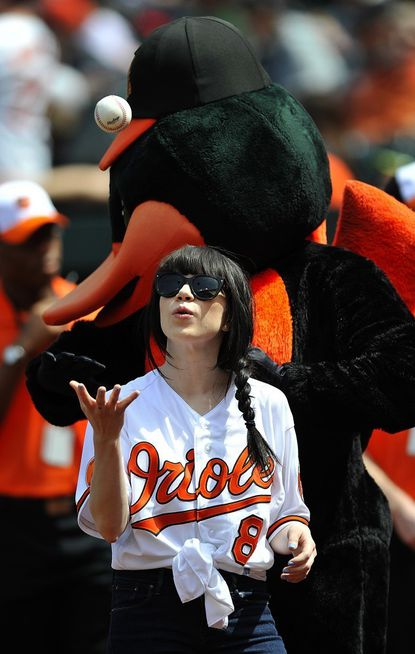 Canadian recording artist Carly Rae Jepsen tosses a baseball before throwing out the ceremonial first pitch before a Baltimore Orioles game in Baltimore in April. Jepsen is returning to the region to perform at the Maryland State Fair Aug. 25.