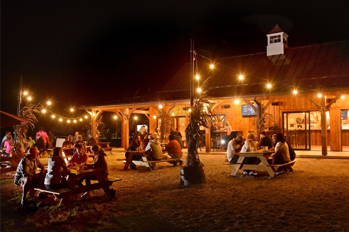 Patrons relax outside the tap room at Hopkins Farm Brewery, which opened in July.