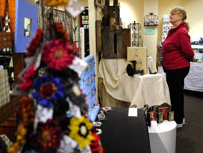 Charlotte Monroe checks out items for sale at the Gallery of Gifts at the Carroll County Arts Center in Westminster Thursday.